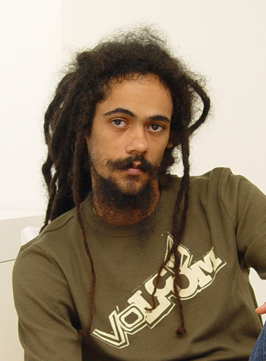 Damian Marley looking gorgeous and posing for the camera in a waffle knit Volcom henley.jpg
