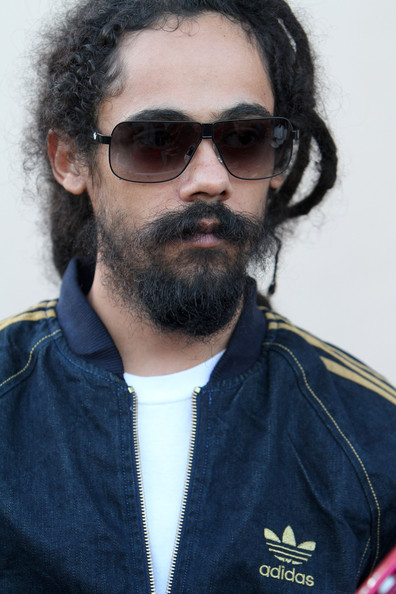 Damian Marley looking hot and secretly incognito in a denim adidas tracksuit.jpg