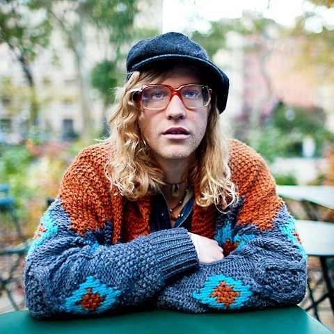 Allen Stone outside thinking while wearing a sweater and looking hot.jpg