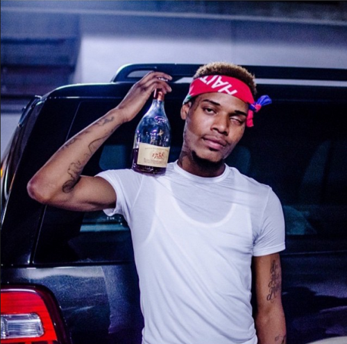 Fetty Wap looking hot in a wife beater and a t-shirt with a bandana on and a 40.jpg