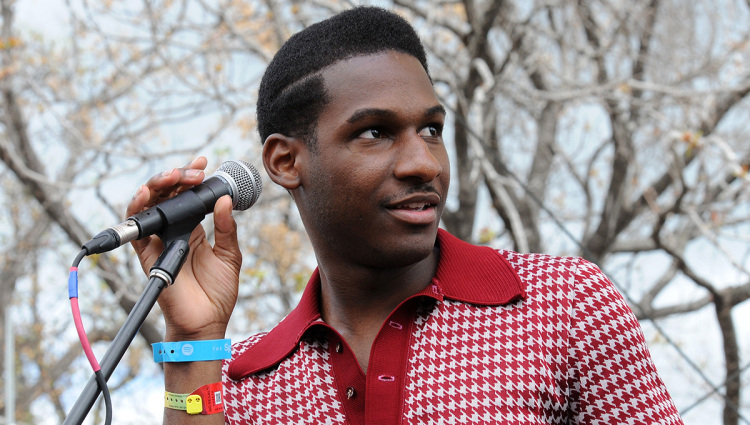 Leon Bridges releasing a coy smile and looking hot.jpg