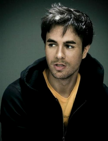 Enrique Iglesias looking gorgeous in a black zip up.jpg