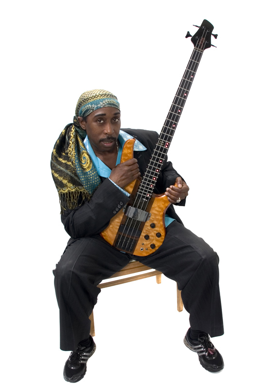 Deon Estus looking hot holding his bass guitar.jpg