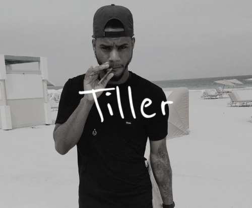 Bryson Tiller looking hot in a greyscale picture smoking a blunt.jpg