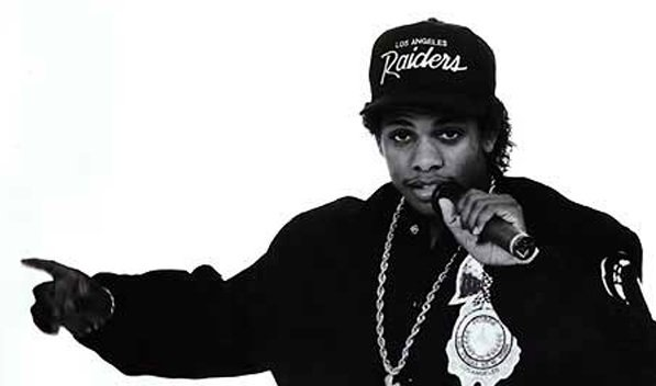 Eazy E looking hot in a greyscale photo of him with the microphone.jpg