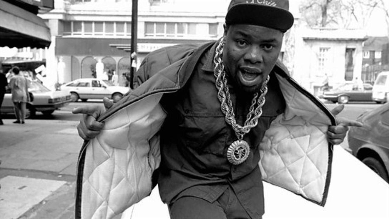 Biz Markie holding open his jacket as he looks hot.jpg