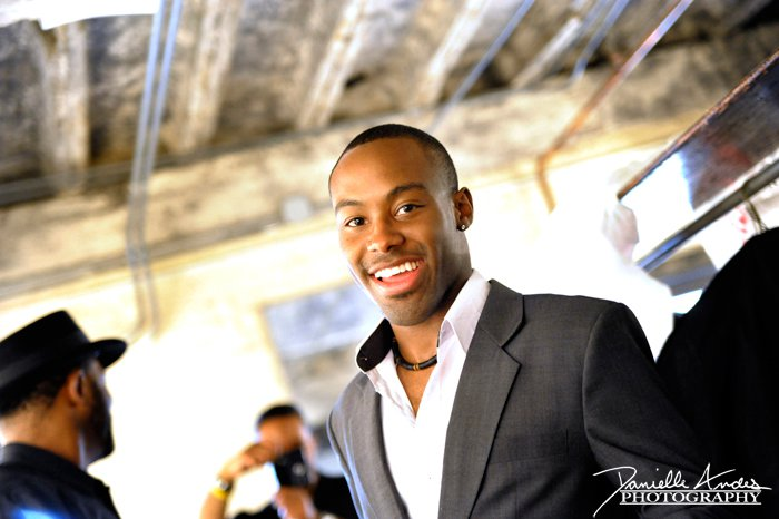 Antoine Dunn smiling and looking so hot with his shirt unbottoned on top at an event.jpg