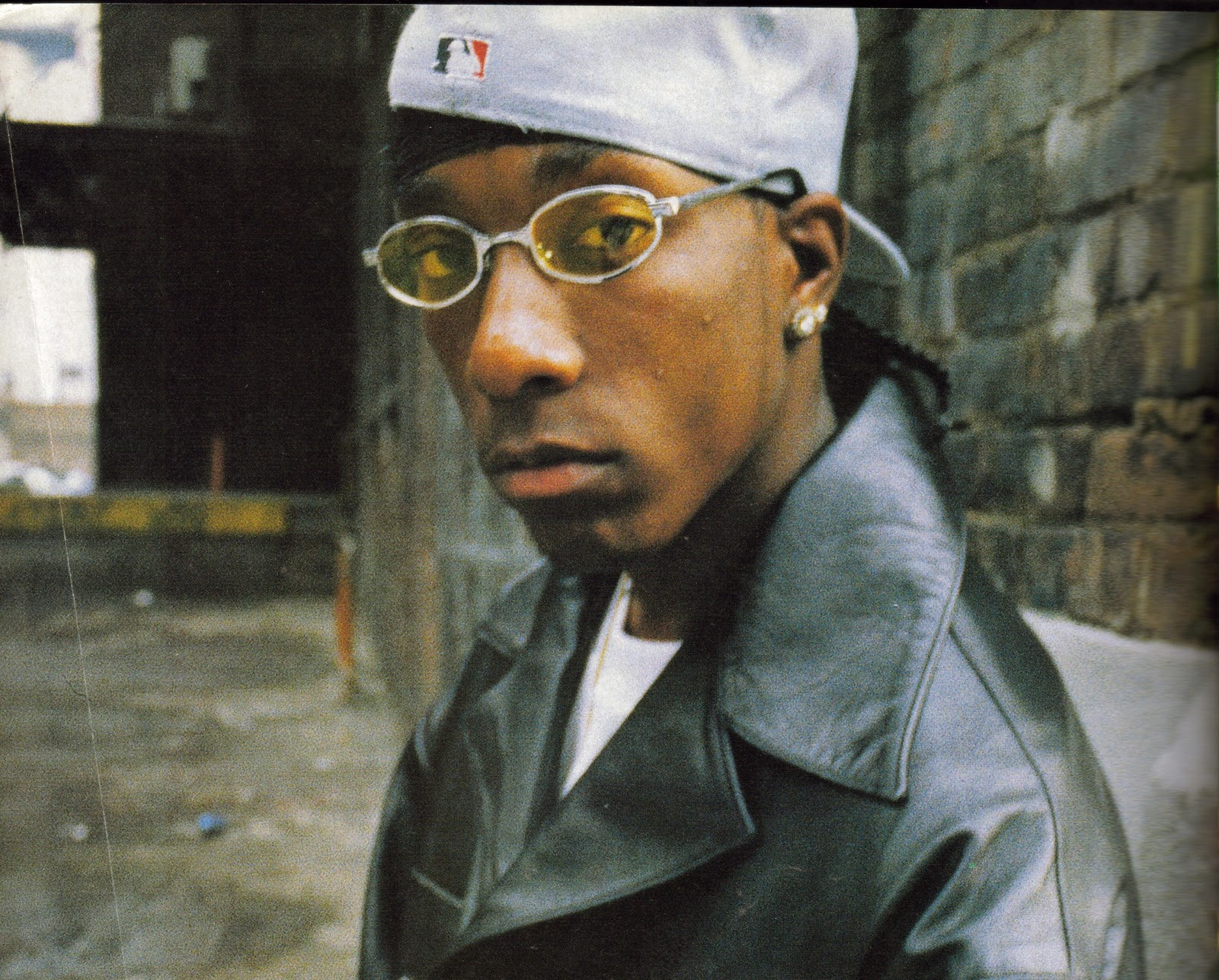 Big L looking hot with his glasses on and he is wearing a light gray yankee fitted and a leather jacket.jpg