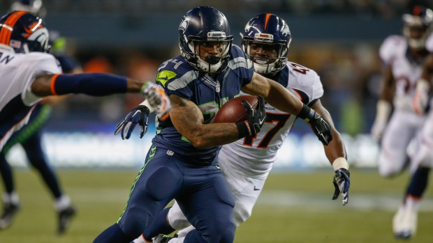 Thomas Rawls running with the ball looking hot during the Broncos game.jpg