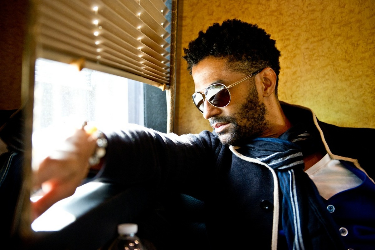 Eric Benét looking hot af in sunglasses and a coat.jpg