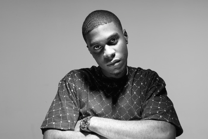 Big K.R.I.T. looking gorgeous af in a greyscale photo with his watch on.jpg