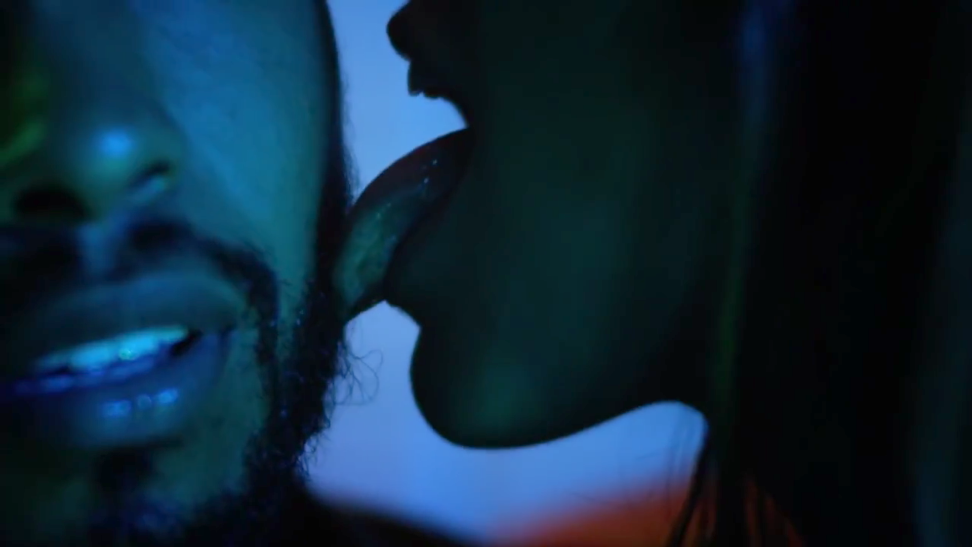 Miguel having the side of his face including his beard licked in the Waves video.jpg