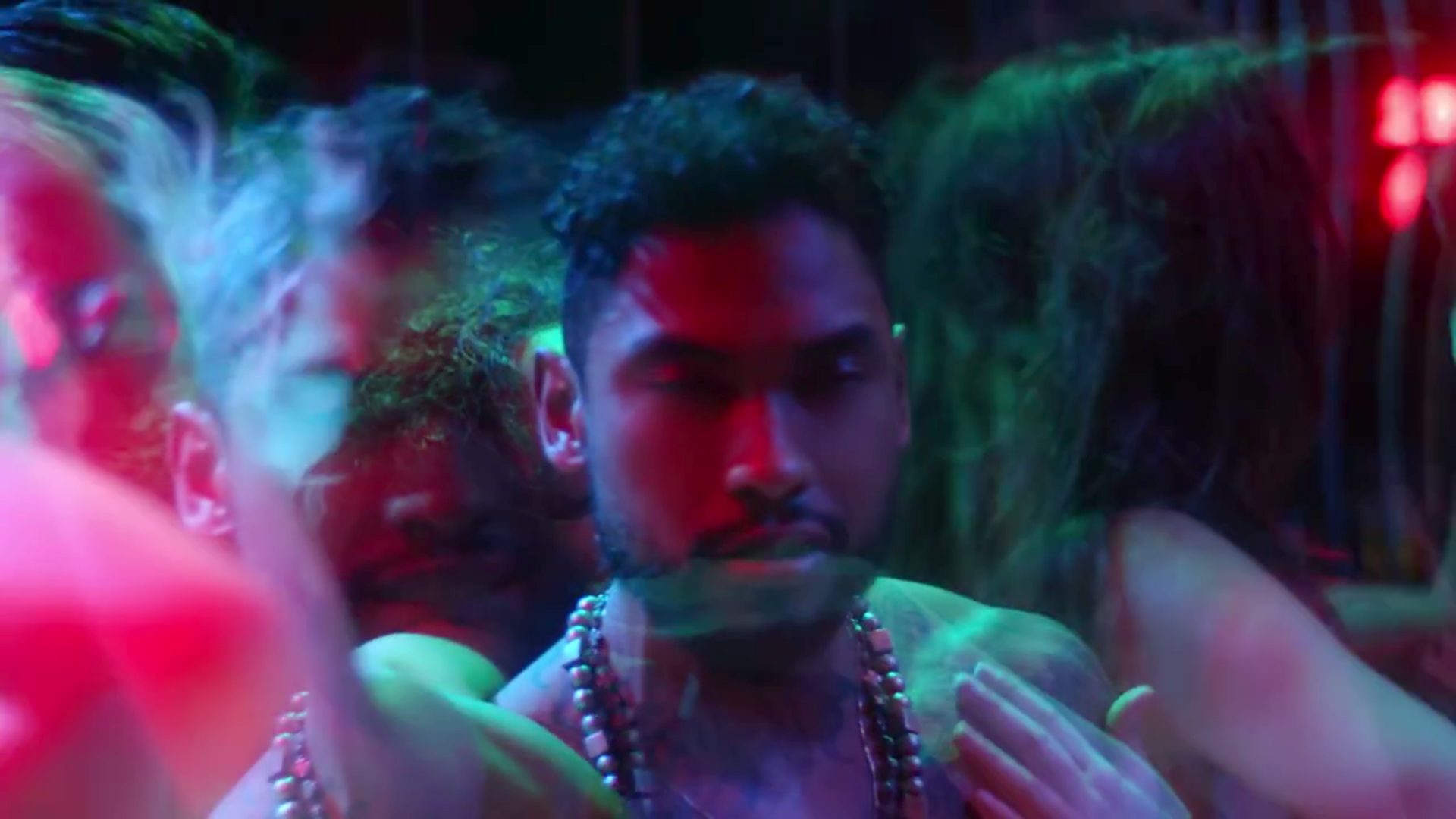Miguel being passed around in the Waves video.jpg