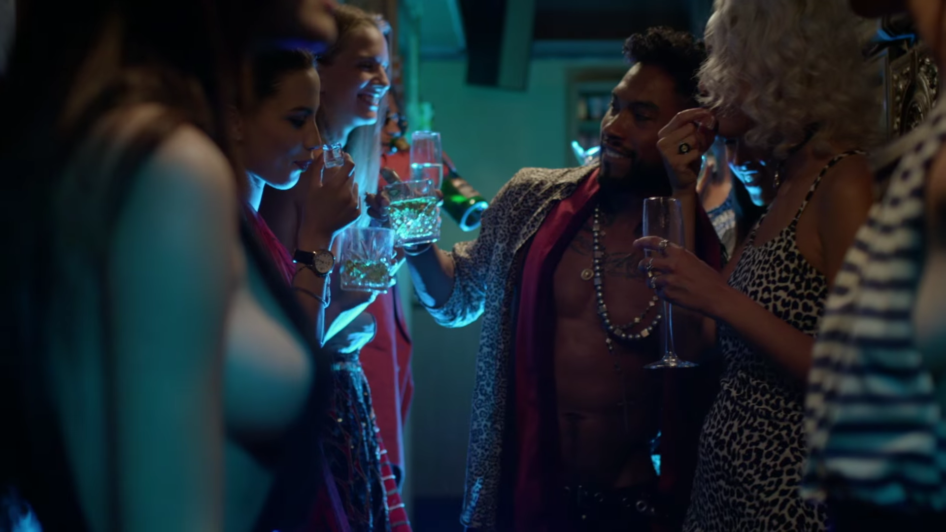 Miguel having drinks with everyone at the party in the Waves video.jpg