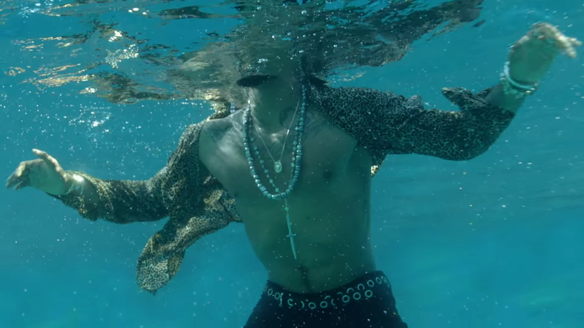 Miguel underwater and going up to the surface for air in the Waves video.jpg