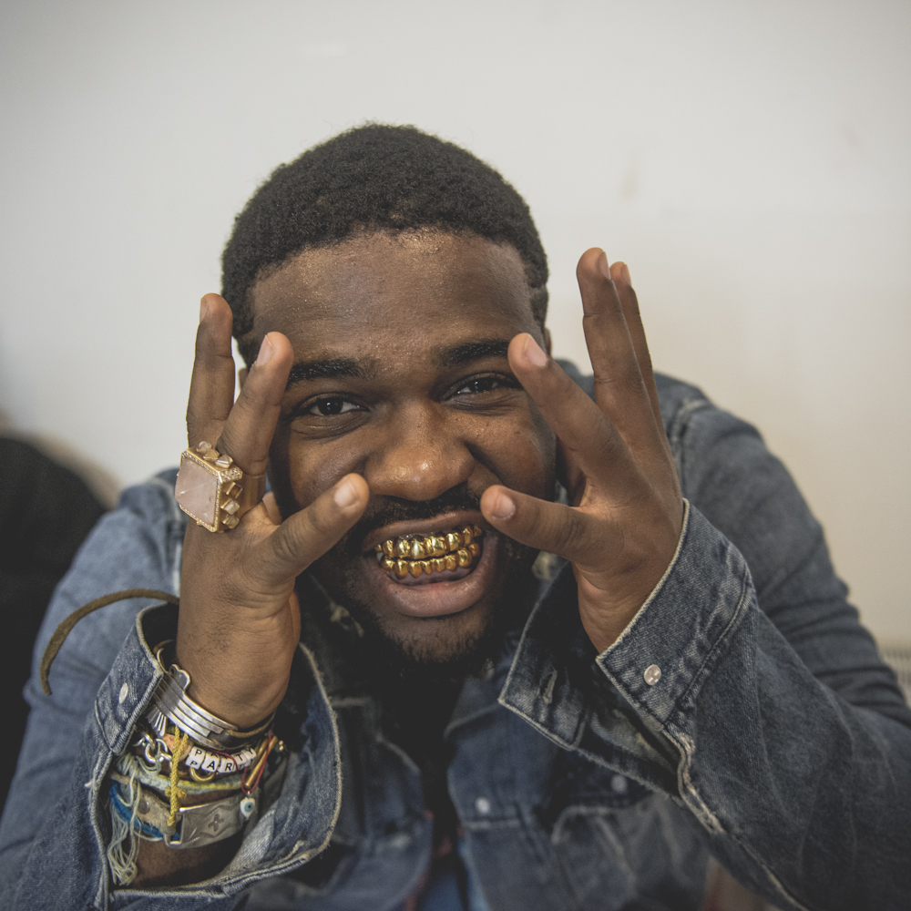 A$AP Ferg looking gorgeous with a gold grille in his mouth in a denim jacket.jpg