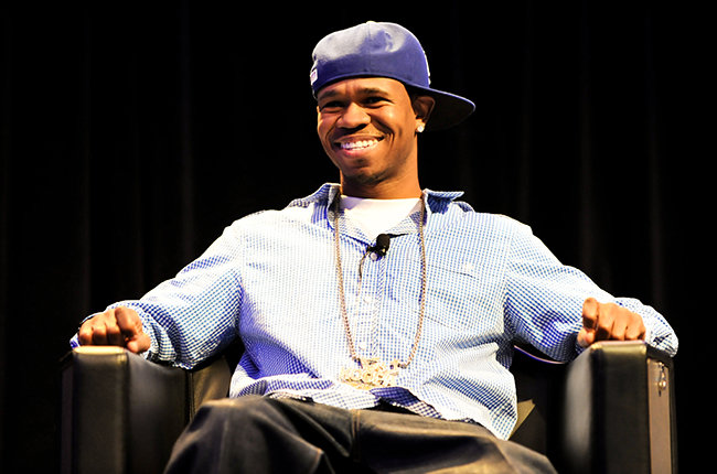 Chamillionaire sitting in a chair looking hot with a gorgeous smile.jpg