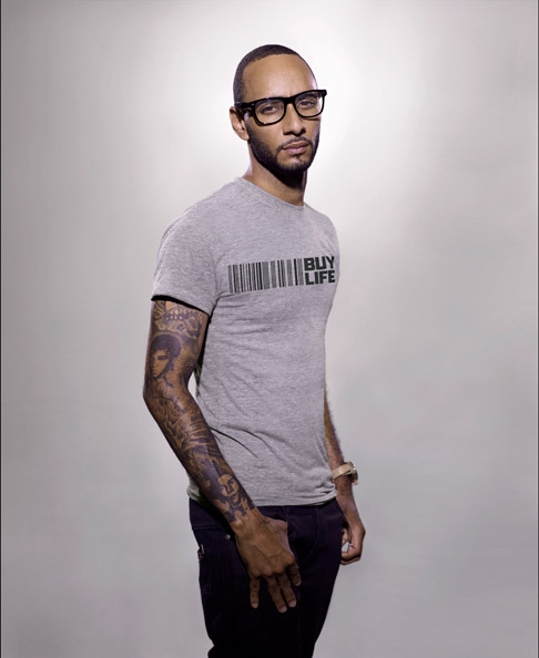 Swizz Beatz looking hot in a grey shirt and glasses.jpg