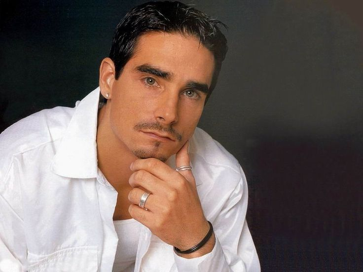Kevin Richardson looking hot in a white dress shirt with a thumb ring on.jpg