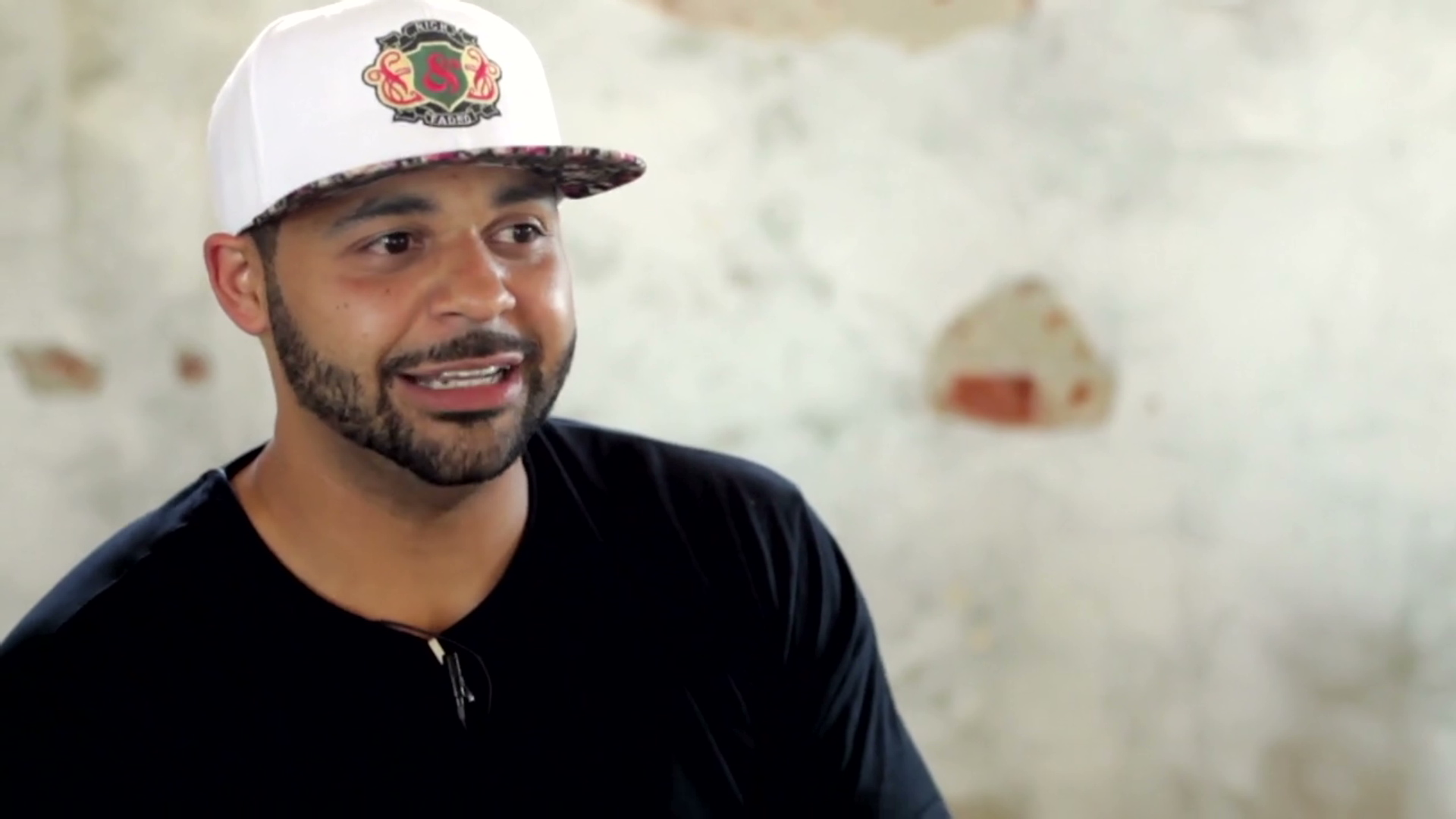 Joell Ortiz looking hot in a black shirt as he smiles and looks even hotter.jpg
