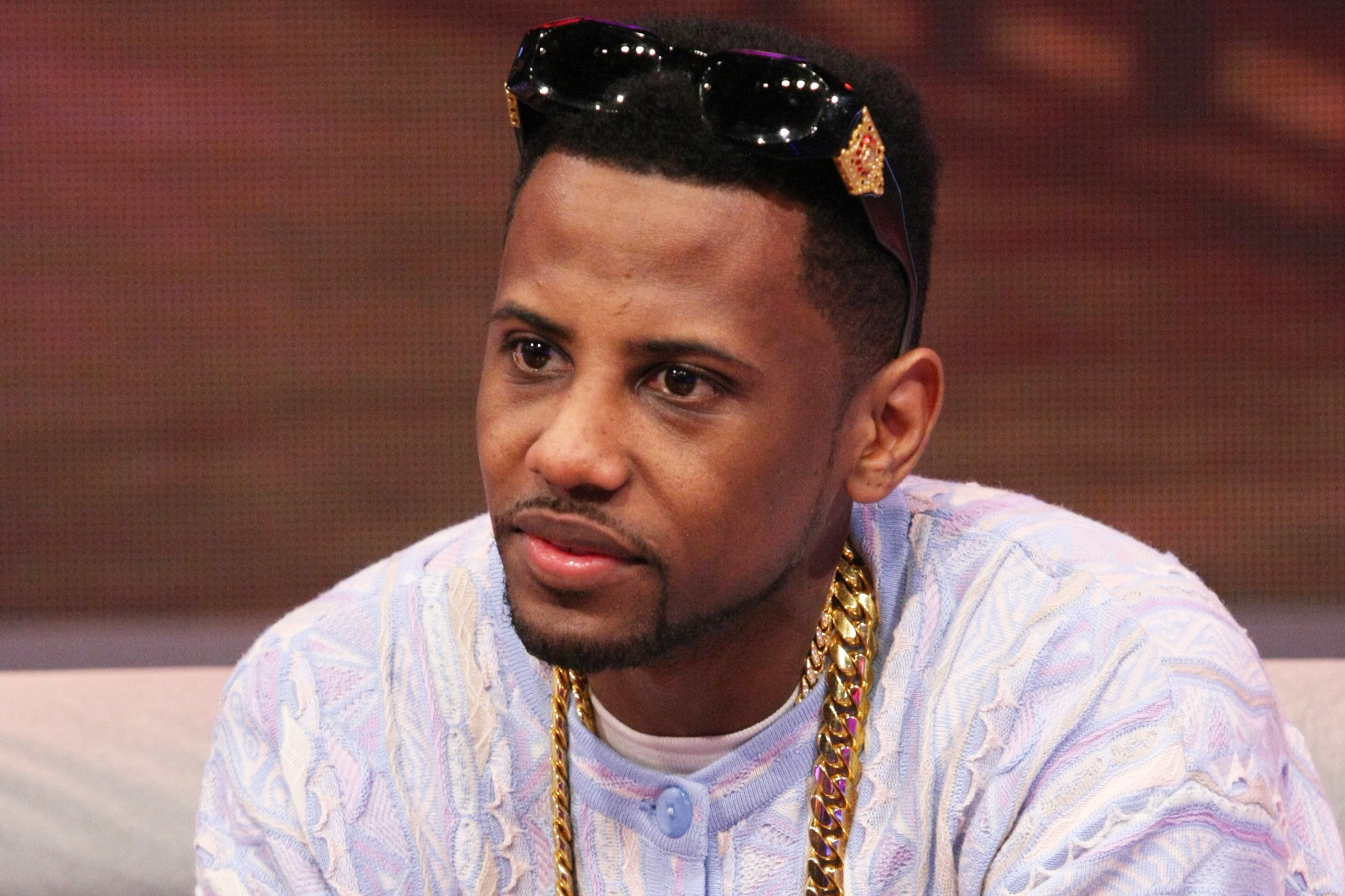 Fabolous looking gorgeous in a pastel shirt with his sunglasses on top of his head.jpg