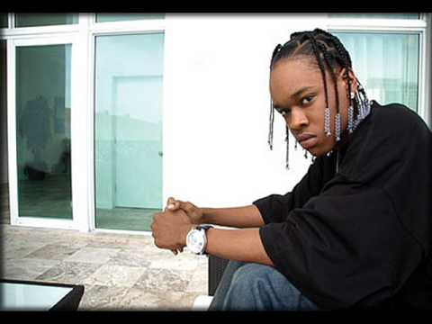 Hurricane Chris sitting in a room with sliding glass doors.jpg