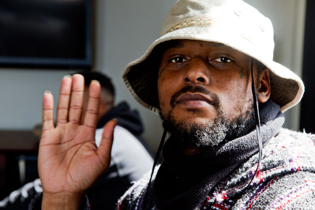 Schoolboy Q looking hot with his hand in the air.jpg