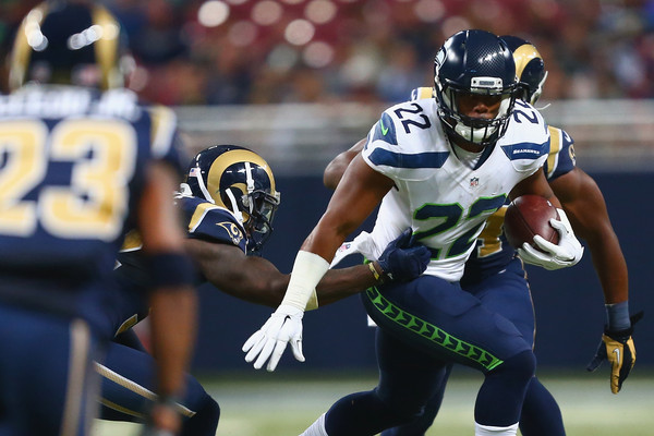 Fred Jackson running with the ball during a game against the Rams.jpg