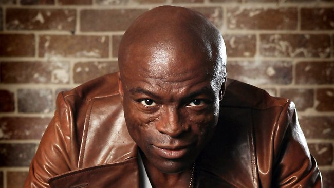 Seal looking hot in a brown leather jacket.jpg