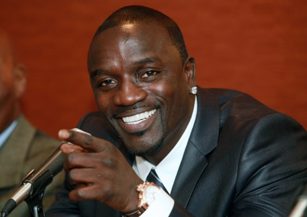 Akon wearing a suit and looking hot with his gorgeous smile.jpg