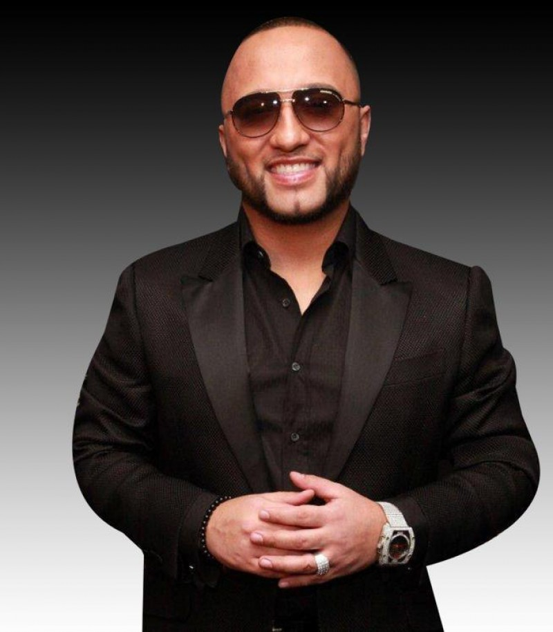 Alex Sensation looking hot and smiling in a black suit.jpg
