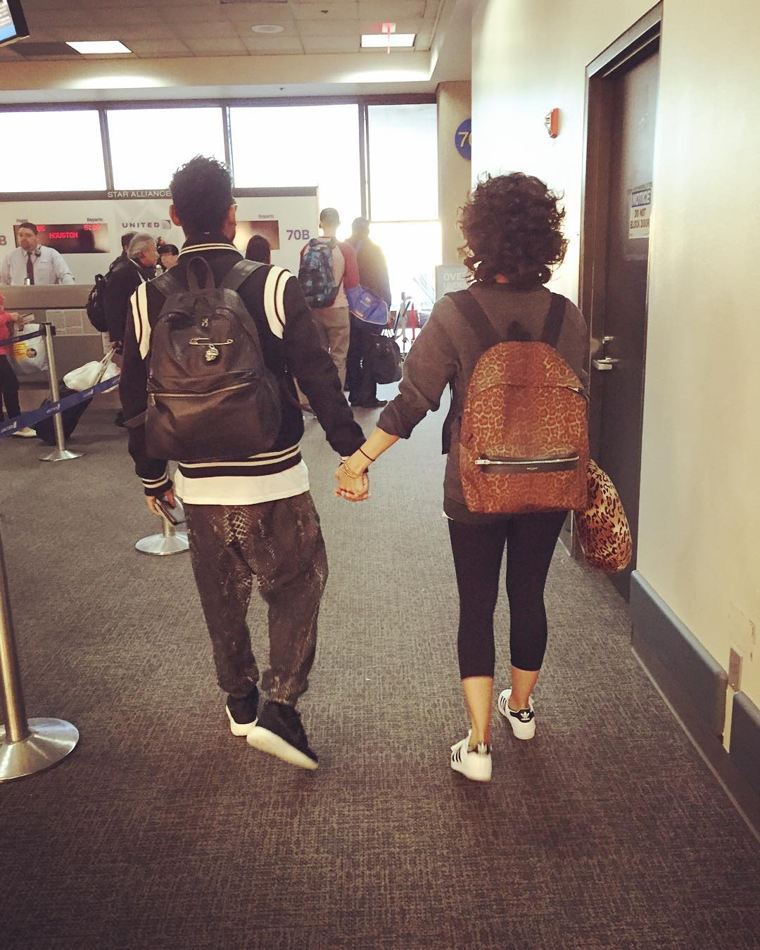 Miguel and Nazanin at the airport going to the Dominican Republic.jpg
