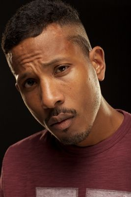 Shyne looking hot with a hot design shaved into his hair.jpg