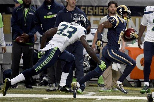 Kelcie McCray looking hot as he tackles some joker on the Rams.jpg