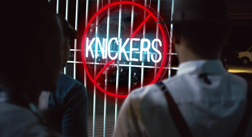 the no knickers sign on the gate in Jidenna's video for Knickers.jpg