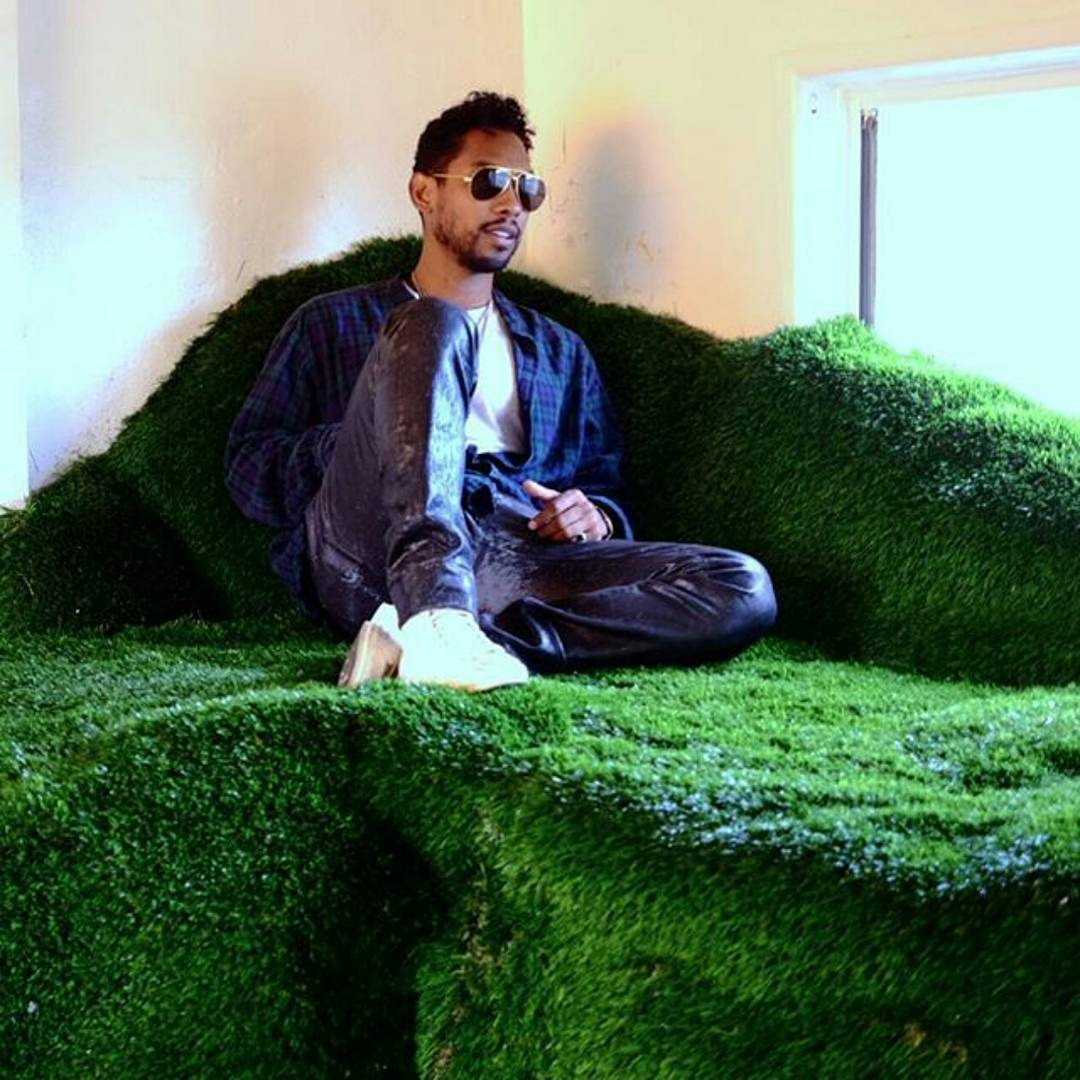 Miguel on the grass hill in the Wildheart Motel.jpg