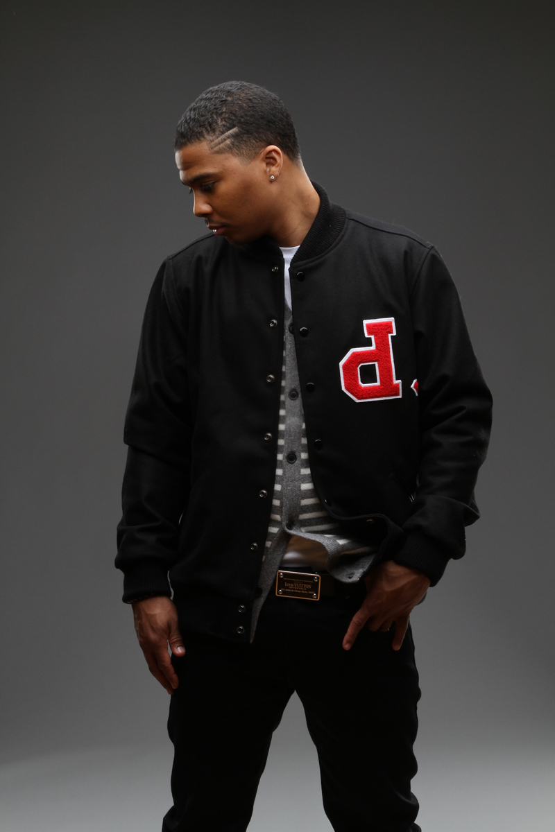 J. Valentine looking hot in his varsity jacket with a P upside down.jpg