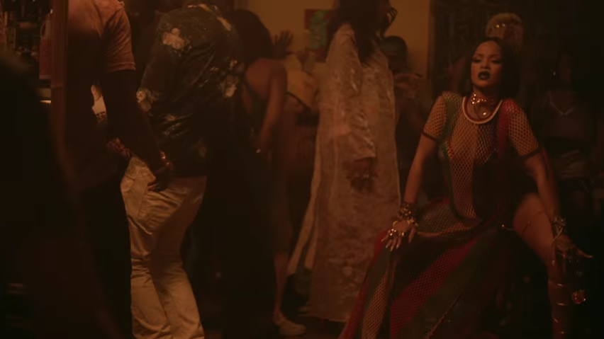 Rihanna looking like she's trying to squat and take a shit in the Work video.jpg