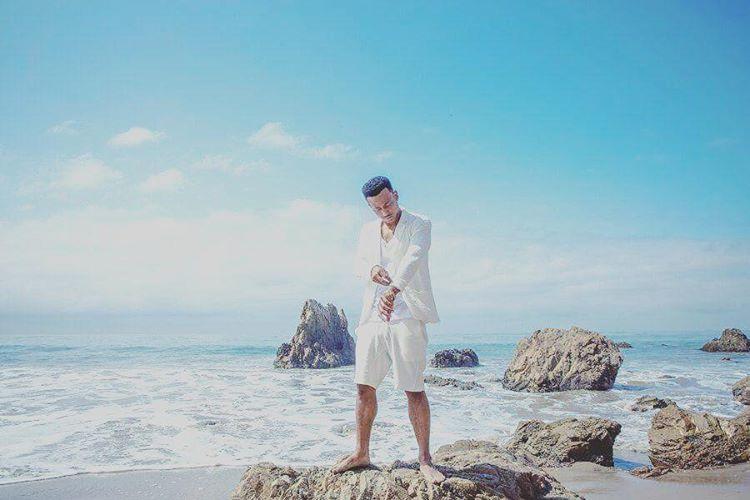 Jimmy Cozier looking hot on an island beach.jpg