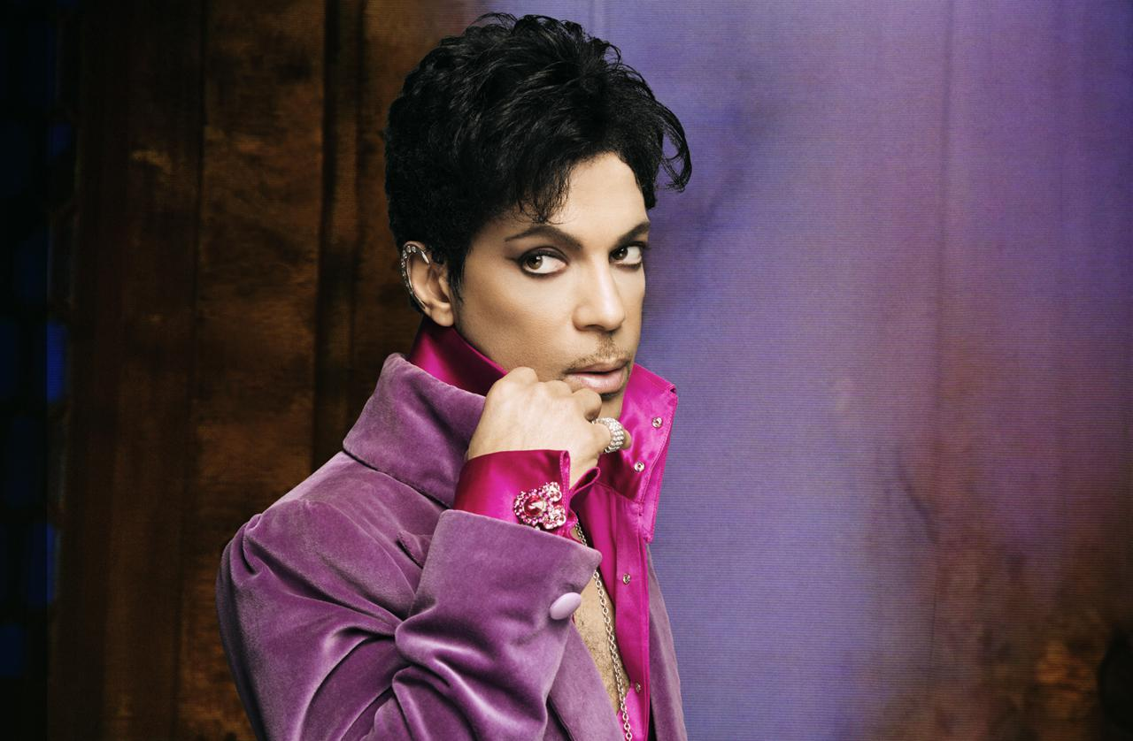 Prince looking gorgeous in a purple suit.jpg