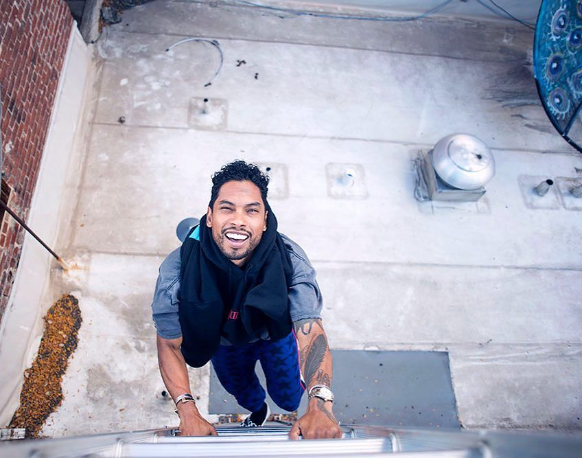 Miguel looking hot and climbing up a ladder on a rooftop.jpg
