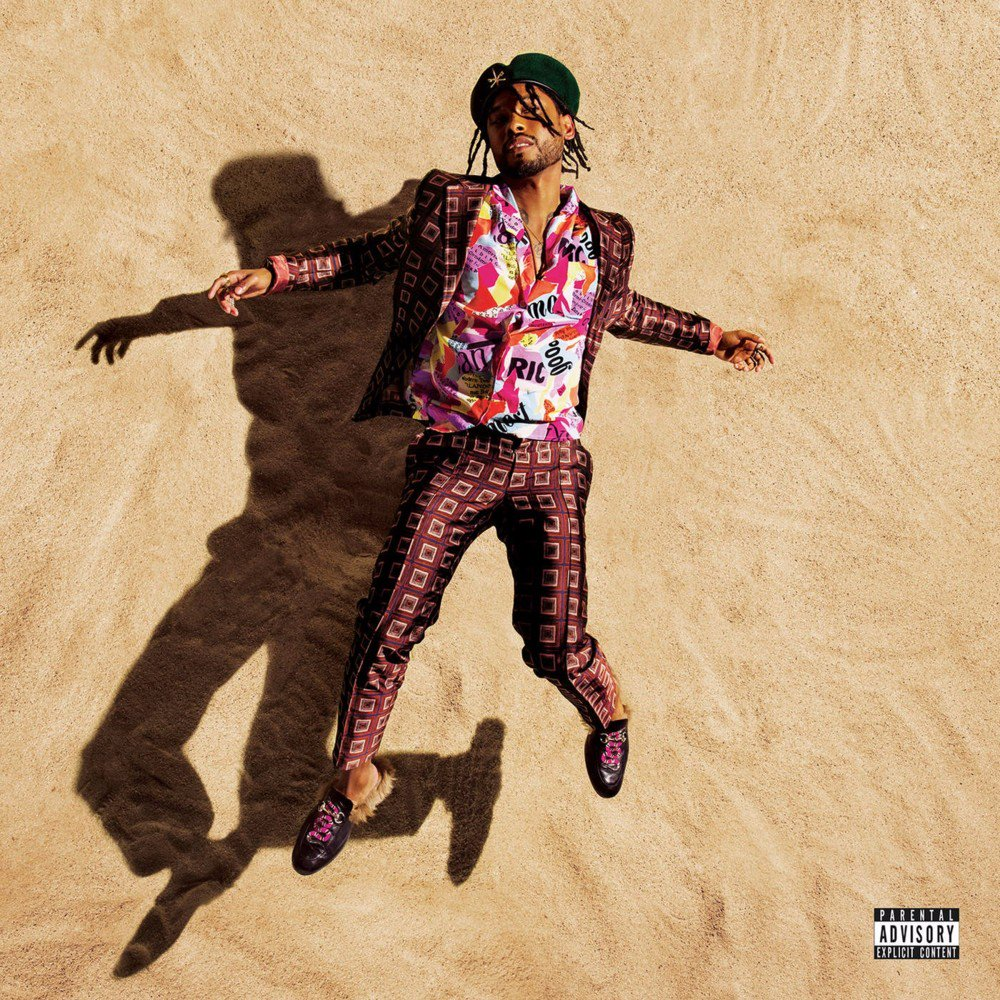 Miguel looking gorgeous on his sand covered War & Leisure album artwork.jpg