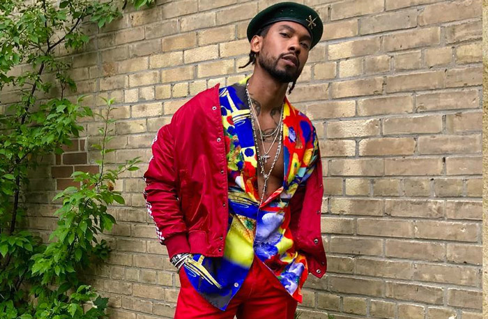Miguel looking absolutely perfect in a hat and a Hawaiian shirt with a red outfit on top.jpg