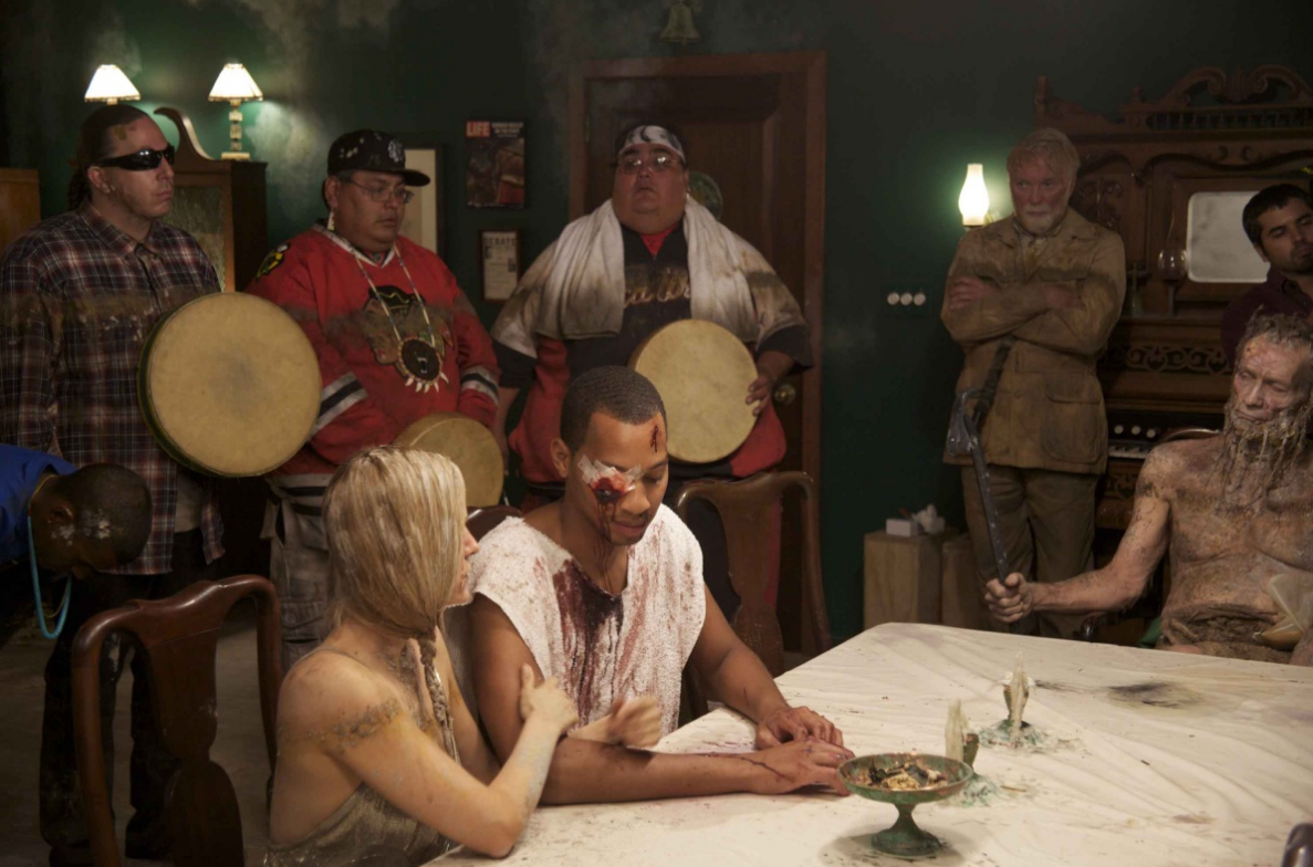 Two pharaohs conclude a battle with silent speeches at the table towards the end of Norman Mailer's wake while the Mystic River Singers sing. The elder at the head of the table is Usermare, Hathfertit's father, one of many creatures from the deep.