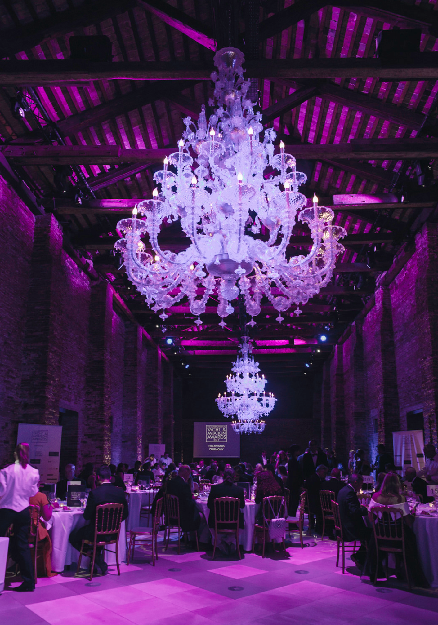 Murano chandeliers set off the rustic venetian brick before the ceremony.