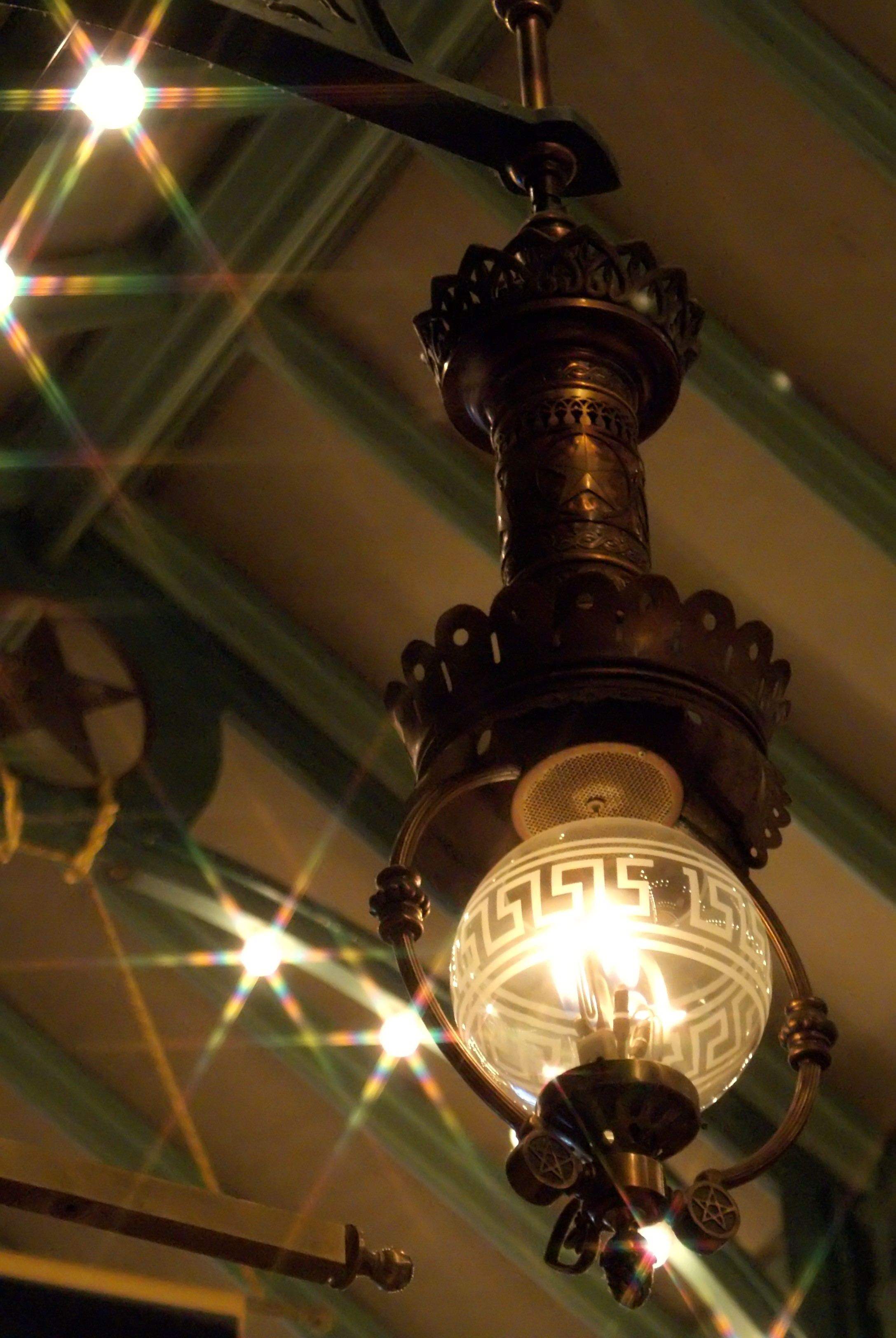The battle for  real gaslights versus light bulbs  was not easily won, but in the end they proved to be what sets the arcades apart. Made by Sugg Lighting of England, they tell the story of a small town in transition from Gas to the new Electric light. .