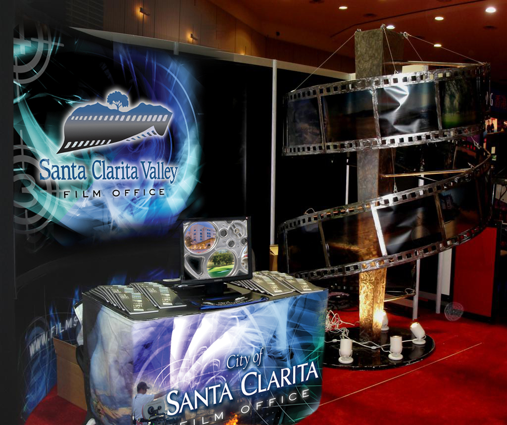Film 20' and 10' back wall graphic, header, table banner, expanding side light panels, and sculpture.