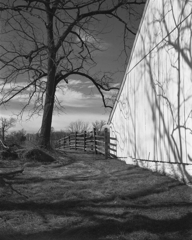 Shadows fall on the side of the barn on the John Slyder Farm at Gettysburg.