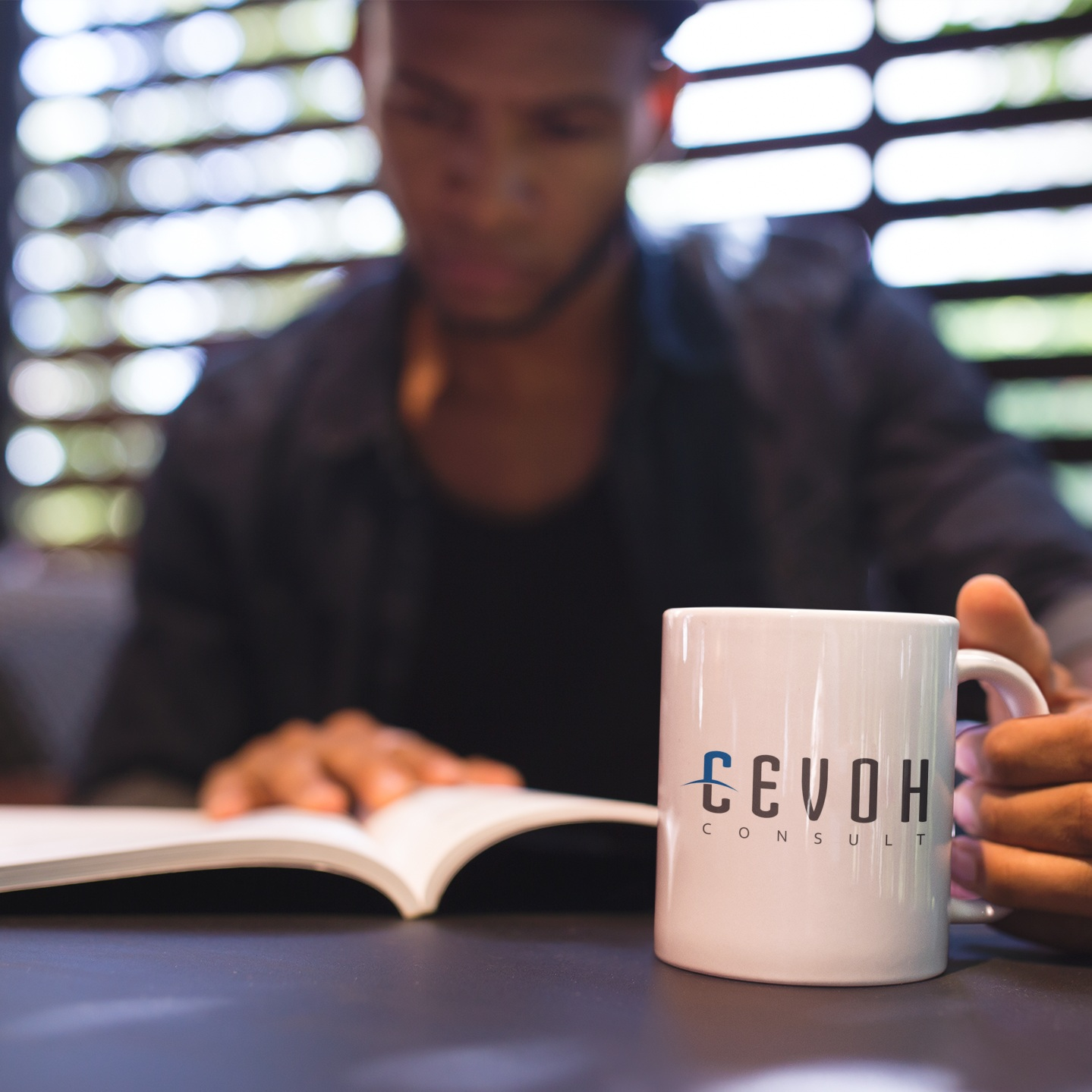 man-reading-a-book-and-holding-a-coffee-cup-mockup-a12296.jpg