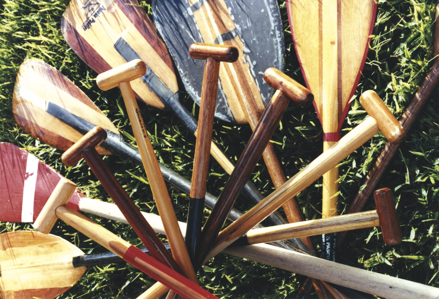 """The Red Blade paddle is from the first winning Tahitian Team in the mid 70s before a series of other victories. Straight shaft, no handle and over 70"""" tall. Significantly, Tahitians even at this time, had a faster stroke rate than that of Hawaiian crews."""